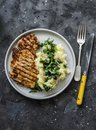 Turkey grilled chop and mashed potatoes with butter spinach on a dark background, top view. Comfort winter autumn home cooked food Royalty Free Stock Photo