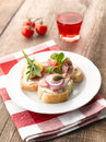 Turkey ham canapes and parma sandwiches with tomato onion caper and raspberry drink Stock Photography