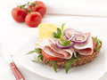 Turkey and ham sandwich with potato chips white background shallow focus Stock Photos