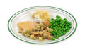 Turkey peas and mashed potato tv dinner a sliced in gravy with croutons potatoes green on a plate Stock Photography