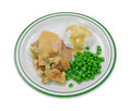 Turkey peas and mashed potato tv dinner a sliced in gravy with croutons potatoes green on a plate Stock Photos