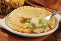 Turkey pot pie a forkful of on a thanksgiving type dinner table setting Royalty Free Stock Image
