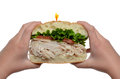 Turkey sandwich hands holding a isolated white background Stock Photos