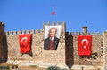 Turkey selçuk atatürk canvas with flags the walls of castle are decorated a picture of mustafa kemal and three turkish Stock Image