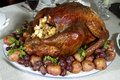 Turkey with stuffing on platter holiday filled a potatoes and grapes Stock Photos