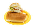 Turkey sub sandwich halved on a yellow paper plate Royalty Free Stock Photo