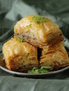 Turkish arabic dessert baklava with honey and nuts on a silver plate Royalty Free Stock Photos