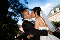 Turkish blue sky wedding kiss