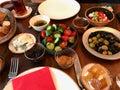 Turkish Breakfast Table with Tea, Coffee, Fresh Jams, Custard / Curd Cheese, Honey, Cream, Bagel and Bread. Royalty Free Stock Photo