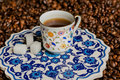 Turkish ceramics in ancient style. Morning cup of coffee on carved platter Royalty Free Stock Photo