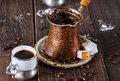 Turkish coffee over dark wooden background Royalty Free Stock Photo