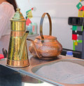 Turkish coffee pot brewed on sand Royalty Free Stock Image