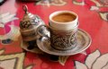 Turkish coffee served in a handmade demitasse cup Royalty Free Stock Image