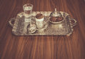 Turkish coffee served with water and cookies n traditional copper serving set
