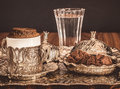 Turkish coffee served with water and cookies in traditional copper serving set