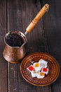 Turkish coffee and Turkish Delight over dark wooden background Royalty Free Stock Photo