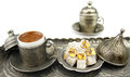 Turkish coffee and turkish delight with traditional cup and tray on white background Stock Photo