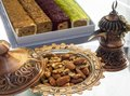 Turkish copper cookware handmade from Turks and candy dish with almonds and walnuts Royalty Free Stock Photo