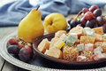 Turkish delight with fresh pears and grapes on metal tray Stock Photography
