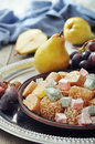Turkish delight with fresh pears and grapes on metal tray Royalty Free Stock Image