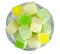 Turkish Delight in glass bowl isolated on white background. Royalty Free Stock Photo