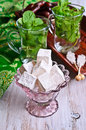 Turkish delight in a glass vase on a background of tea with mint Royalty Free Stock Image
