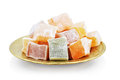 Turkish delight lokum on metal plate on white Royalty Free Stock Photo