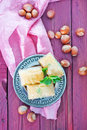 Turkish delight on the metal plate and on a table Royalty Free Stock Photos