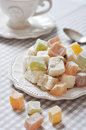 Turkish delight with nuts on checkered tablecloth closeup Stock Photography