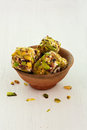 Turkish delight with pistachios in clay pot Royalty Free Stock Images