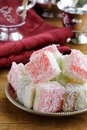 Turkish delight rahat lokum dessert in coconut flakes Stock Image