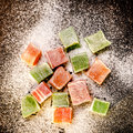 Turkish delight random pieces of on black background Royalty Free Stock Photos