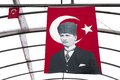 Turkish flag with ataturk a large the founder of modern turkey atatürk hangs in a market area near cappadocia Stock Images