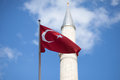 Turkish flag in front of minaret Royalty Free Stock Photo