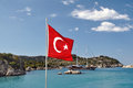 Turkish flag of turkey against the backdrop of mountains sea sky and yachts Royalty Free Stock Images