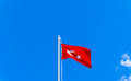 Turkish flag waving in blue sky