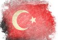 Turkish flag waving in the wind with some spots and stains Royalty Free Stock Images