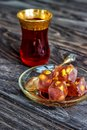 Turkish joys with different nuts is a glass of tea and a spoon. Eastern sweets. Traditional Turkish delight Rahat lokum on a Royalty Free Stock Photo