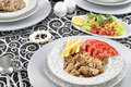 Turkish kebab with french fries and tomatoes on dish Stock Photography