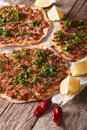 Turkish lahmacun closeup on a wooden table. vertical Royalty Free Stock Photo