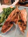 Turkish Leer Fish Akya Baligi / Leerfish or Kuzu Baligi served at Restaurant with Arugula Rocket leaves.