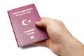 Turkish passport isolated in the hand Royalty Free Stock Photo