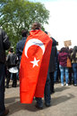 Turkish protester a covered with a flag in hyde park london is supporting the protesters in istanbul following the Royalty Free Stock Image