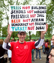 Turkish protester a man in hyde park london is supporting the protesters in istanbul turkey following the demonstrations spiralled Stock Photo