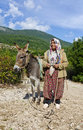 Turkish rural woman in traditional dress kemer turkey turkey a village the mountains near kemer old village national with a donkey Royalty Free Stock Image