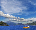 Turkish seascape a beautiful landscape of marmaris with a sailing yellow boat Stock Photos