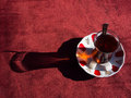 Turkish tea with nice shadow close up of traditional glass and plate together at outdoor Stock Photo