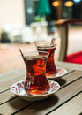 Turkish tea in traditional tulip glasses on table of street cafe Royalty Free Stock Photo
