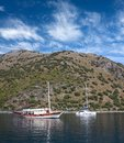 Turkish touristic boat and yacht over calm sea Royalty Free Stock Photo