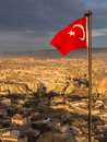 Turkish village and flag overview of ortahisar from the castle tower at sunset with the national flying near urgup cappadocia Stock Images